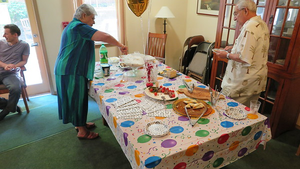 Ouma and her friend laying out the spread for their birthday celebration.